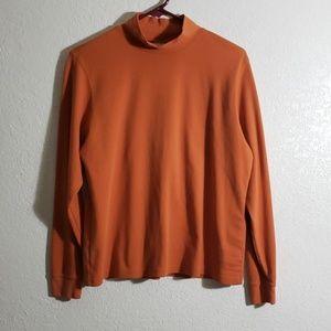 100% Cotton long sleeve terracotta.